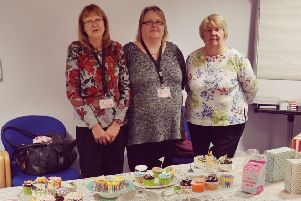 The Great Care Company staff with some of the cakes.