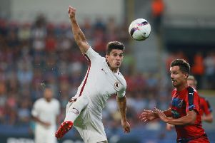 Viktoria Plzen's  Ales Mateju (R) and Roma's Diego Perotti vie for the ball during the UEFA Europa League Group E football match FC Viktoria Plzen v AS Roma in Plzen, Czech Republic on September 15, 2016. / AFP / Radek Mica        (Photo credit should read RADEK MICA/AFP/Getty Images) SUS-190107-164848002