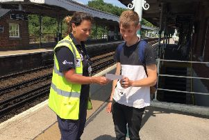Pulborough Neighbourhood Warden Vanessa Green talking to a local young man at Pulborough Station about the drugs campaign. SUS-190807-171045001