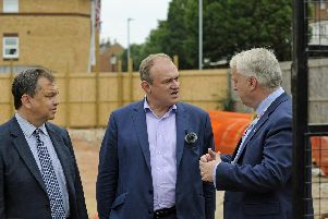 Lib Dem leader candidate Ed Davey chats to Councillor Darren Sanders (left), and Councillor Gerald Vernon-Jackson during a visit to a new city build in Somers Town.'Picture Ian Hargreaves  (100719-06)