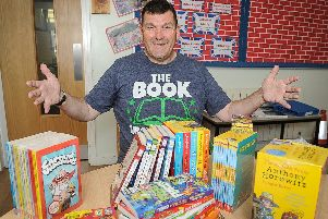 Rev Sean Blackman with some of the books he's provided for Grange Infant and Junior schools.''Picture: Habibur Rahman
