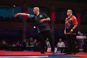 Rob Cross in action against Stephen Bunting. Picture by Lawrence Lustig/PDC