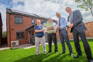 Warwick District Councils Cllr John Cooke, Cllr Alan Rhead and Dave Barber with AC Lloyd Homes Alistair Clark