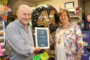 Mayor of Mid and East Antrim Council Maureen Morrow congratulates Eugene Diamond on 40 years of business in Ballymena