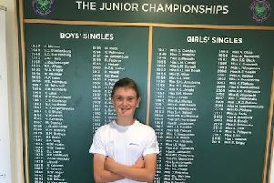 William Taunton in front of the Wimbledon junior championships honours board
