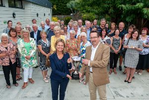 The Rustington Chamber of Trade 60th anniversary event. Members past and present. Sarah Wickens (Store Property) and Andy Cooper (current Chairman of the Chamber of Trade and Commerce) with the Business Award Cup and �1000 prize money. Picture: Scott Ramsey