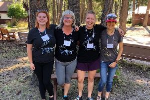 Anna, second left, with the CARE team for a group of 11 girls aged between 12 and 14 in a lakefront bunkhouse at A Camp to Remember