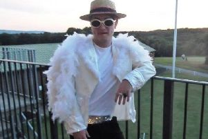 Sam Hughes as Sir Elton John