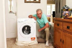 Paul Darnes from Rustington with the faulty washing machine. Picture: Derek Martin