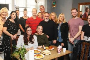 Former Thomas Cook employees receiving their free breakfast at Cocks Kitchen