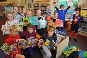 Pupils with books purchased for White Meadows Primary School in Littlehampton from all over the world after they set up an Amazon Wish List . Picture: Steve Robards SR18101905