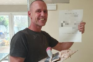 Gareth Riley with the invoice to the Northampton couple whose bathroom he fitted for free