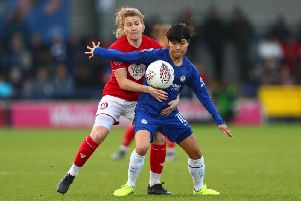 So-Yun Ji  battles for the ball with Frankie Brown of Bristol City during the Barclays FA Women's Super League match (Photo by Dan Istitene/Getty Images)