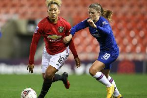 Lauren James of Manchester United and Maren Mjelde of Chelsea FC on the ball during the FA Women's Continental League Cup Semi-Final  (Photo by Charlotte Tattersall/Getty Images)