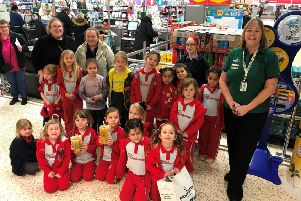 Alison Whitburn, community champion at Morrisons Littlehampton, with 1st Arundel Rainbows