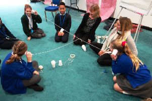 Using plastic cups and string for a listening activity