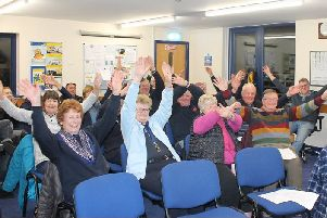 Littlehampton fundraisers demonstrate the distress signal used by sailors to catch people's attention. Picture: RNLI/Anthony Fogg