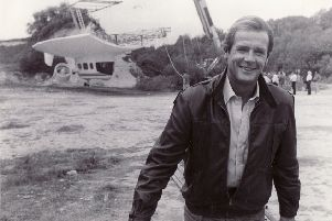 Roger Moore during the filming of A View To A Kill at Amberley Museum