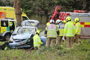 Firefighters rescued two people from the vehicle