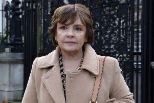 Dana outside the High Court before the settlement of her case was announced