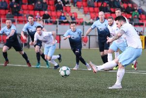 Ballymena United's Cathair Friel fires home from the penalty spot.