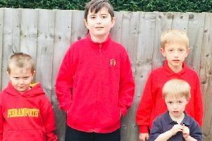 Baginton brothers Mason and Thomas (left and centre) and brothers Ben and James (right) are from families who would be affected by the changes to the free school bus service provision for the village.