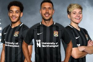 The new Cobblers away kit is modelled by Cobblers defenders Jay Williams and Joe Martin, and Alex Bartlett from Northampton Town Ladies