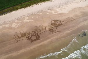 Downhill Strand -  a  giant sand sculpture created by a group of award-winning sand artists called Sand in Your Eyes  appeared on Downhill Beach on Wednesday