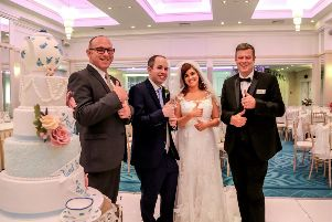 Samantha and Luke are pictured with Roe Park Resort Duty Mangers Kevin Hunt (left) and Brian Lowney who put their Hands That Talk sign language training into practice on the couple's wedding day