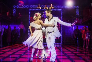 Richard Winsor puts on the white suit as Tony Manero in Saturday Night Fever. Picture by Pamela Raith
