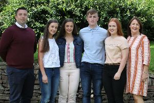 The Quinn twins, Aine and Emer, and the Black twins, Ciaran and Gemma, who between them they gained 4A*, 6A and 3B grades