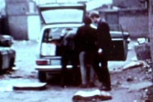 IRA men, one of whom is allegedly Martin McGuinness, load what appears to be components for an explosive device into a car in Derry in 1972. Photo: BBC NI Spotlight.