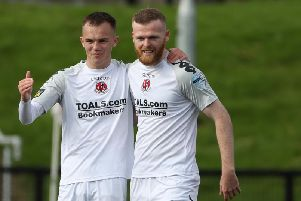 Crusaders Rory Hale (left) congratulated by team-mate Ross Clarke after scoring against Institute.