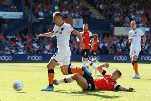 Luke Bolton slides in during yesterday's 3-0 defeat to Hull City