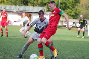Cliftonville's Ronan Doherty shields the ball away from Institute midfielder Conor Tourish,