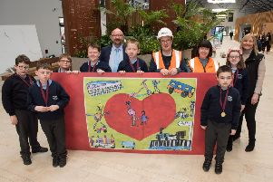 P6 pupils from Ardnashee School during their visit to the North-West Transport Hub; they are joined by (l-r) Mark Montgomery, Assistant Route Manager, Translink NI Railways; Darren McIvor, Site Manager, Farrans; Lisa McFadden, North-West Transport Hub Project Manager, Translink; and Nicola Laight, Farrans.