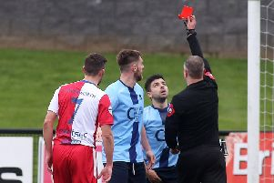 Institutes Ryan Morrow is sent off by match referee Raymond Crangle at Brandywell Stadium on Saturday.