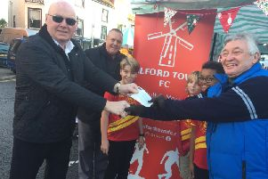 Andrew Leaper (The Worshipful Master) from the Hamilton Masonic Lodge in Alford ( left) hands over a 500 cheque to Alford Town Football Clubs chairman, Keith Thrower, at the Alford Christmas Spectacular Market. Others in the'picture are (from left) Paul Darlaston (also from Alford Masons), and Morti Woodhall,'Truman Woodhall & Sam Howards (all from the Alford Town U12 Robins team).
