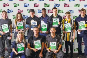 Winner Callum Abberley (back, third from left) alongside other finalists from Screwfix's Top Trade Apprentice competition last year.