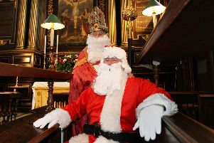 Inside the glorious All Saints Church in Northampton town centre,  St Nicholas poses with Father Christmas before the Feast of St Nick carol concert in 2010.