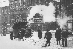 Clearing away the snow from Northampton's Drapery at its junction with Gold Street are four workmen with shovels. The lorry in the middle of the road is steam-powered which must have provided a welcome warming presence during the harsh winter of 1947 which began on January 21st. Several cold snaps brought wide-spread chaos with coal shortages at power stations resulting in  domestic electricity supplies restricted to a chilly nineteen hours a day. Crops rotted in fields adding extra hardship on top of rationing, still in place after the Second World War. 'The thaw in Mid-March caused widespread flooding throughout the UK.