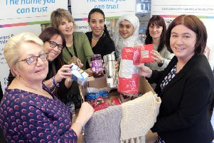 Bedfordshire Euro MP Alex Mayer swapped stitching together alliances in Europe for knitting together scarves for Age UK Bedfordshire's annual 'Hot Box' campaign