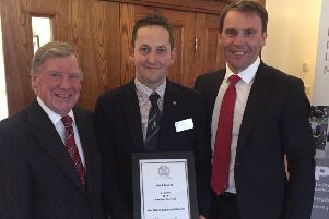 Paul (centre) collects his Midlands PGA award from Robert Maxfield, chief executive of the PGA, and his mentor Eric Sharp EMN-190131-114745002