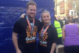 Jessica Lowe with her friend, Ben Crampton, at the Lincoln 10K three years ago.