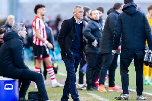 Keith Curle and opposite number Danny Cowley gave the fourth official a busy afternoon at Sincil Bank. Picture: Kirsty Edmonds