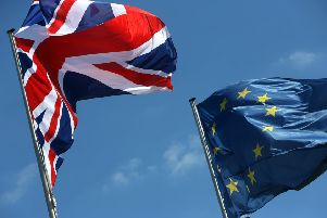 A British Union Jack and European Union flag fly