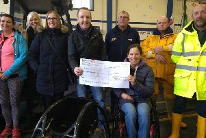 Mablethorpe Running Club chairman Wayne Kew with para-athlete Liz McTernan EMN-190403-163442002
