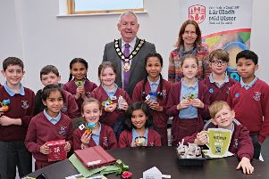 The Chair of Mid Ulster District Council, Councillor Sean McPeake is pictured with Yvonne Zellmann, Mid Ulster District Council and pupils from St Patrick's Primary School, Dungannon, at the Fairtrade event.