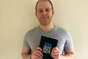 James Berg with his new book