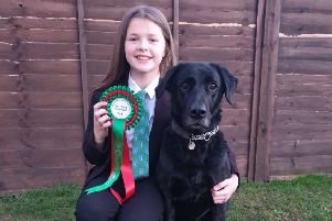 Grace Smith celebrates her Crufts success alongside Floyd.